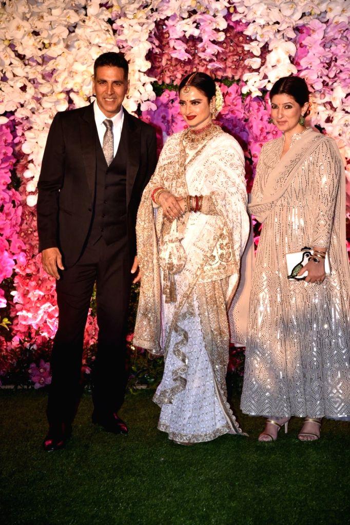 Actor Akshay Kumar along with wife Twinkle Khanna and actress Rekha at the wedding reception of Akash Ambani and Shloka Mehta in Mumbai on March 10, 2019. - Akshay Kumar, Rekha, Khanna, Akash Ambani and Shloka Mehta