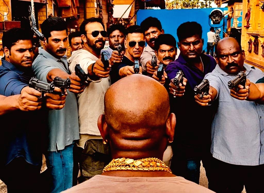 "Actor Akshay Kumar and some of the team members of ""Sooryavanshi"" shot at the cop drama's fight master, who kept them ""all alive during this epic crazy month"". Akshay shared this photograph of Sunil Rodrigues, the action director of ""Sooryavanshi"", o - Akshay Kumar"