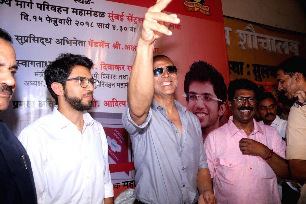 Actor Akshay Kumar and Yuva Sena chief Aaditya Thackeray during the inauguration of a sanitary napkin vending machine at Mumbai Central ST bus depot in Mumbai on Feb 15, 2018. - Akshay Kumar