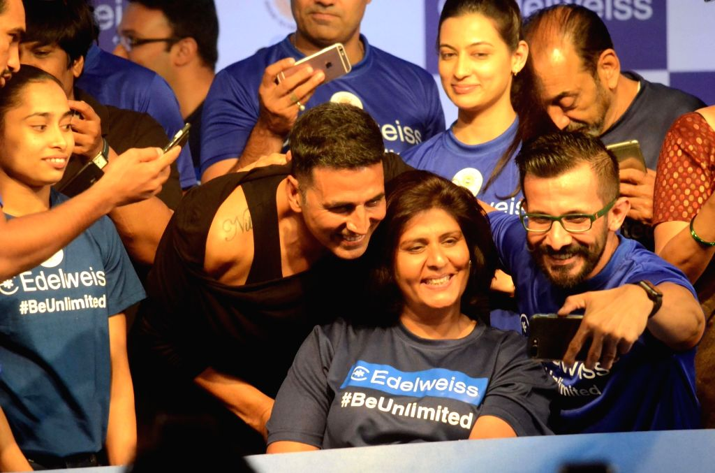 Actor Akshay Kumar poses for selfies with para-athlete Deepa Malik during a programme organised to extend best wishes to the athletes who will be representing India in the upcoming 18th Asian ... - Akshay Kumar and Malik