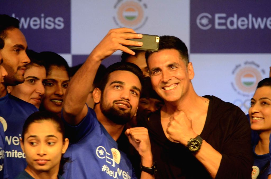 Actor Akshay Kumar poses for selfies with the athletes who will be representing India in the upcoming 18th Asian Games during a programme organised to extend best wishes to them, in Mumbai on ... - Akshay Kumar