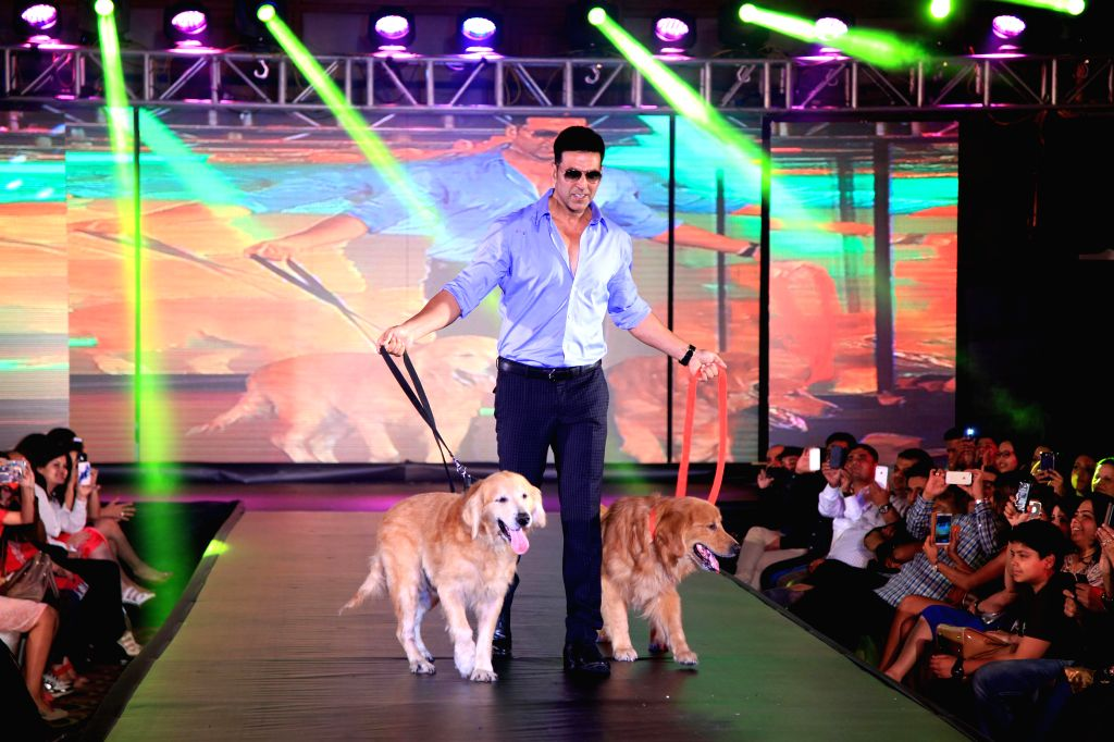 Actor Akshay Kumar walk the ramp with dogs during the promotion of film Entertainment in Bengaluru on August 5, 2014. - Akshay Kumar