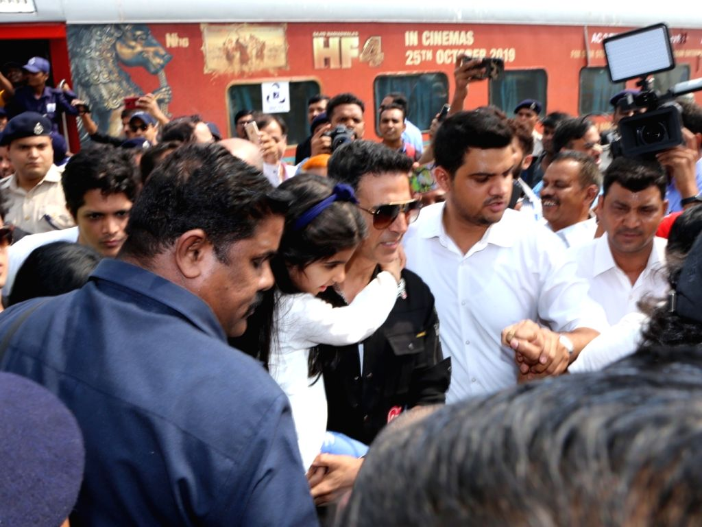 Actor Akshay Kumar with his daughter Nitara Kumar after reaching the New Delhi Railway Station, on Oct 17, 2019. On October 16, the team of the upcoming comedy 'Housefull 4' became the ... - Akshay Kumar and Nitara Kumar