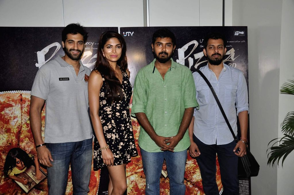 Actor Akshay Oberoi, Parvathy Omanakuttan, filmmaker Akshay Akkineni and Bejoy Nambiar during a media interaction of film Pizza in Mumbai, on July 1, 2014. - Akshay Oberoi
