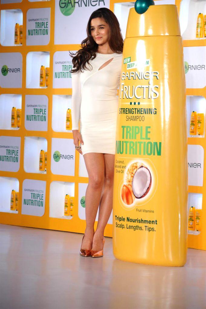 Actor Alia Bhatt during the launch all new Triple Nutrition product of Garnier Fructis in Mumbai on August 11, 2014. - Alia Bhatt