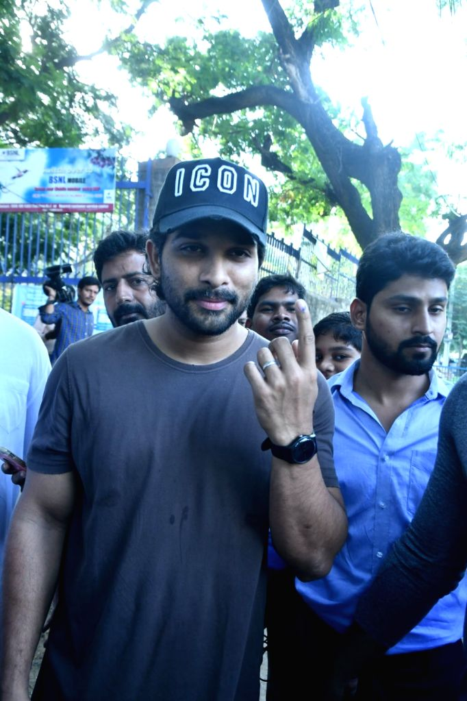 Actor Allu Arjun shows his inked finger after casting vote for Lok Sabha election, in Hyderabad, on April 11, 2019. - Allu Arjun