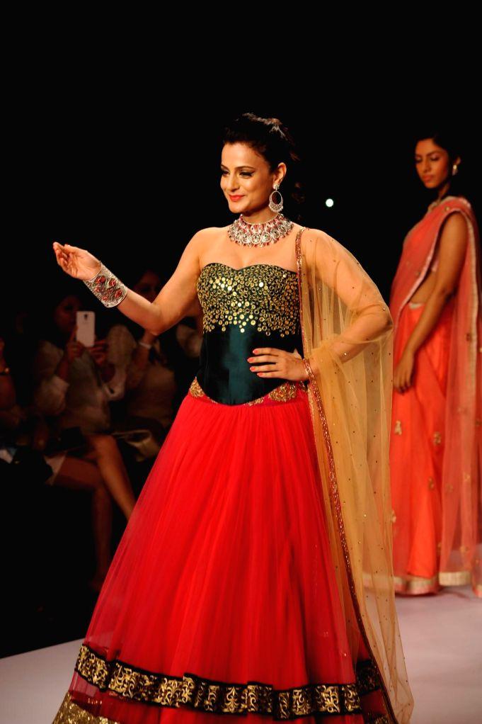 Actor Amisha Patel display jewellery by Swaroski Jeweller during the India International Jewellery Week (IIJW) in Mumbai, on July 14, 2014. - Amisha Patel