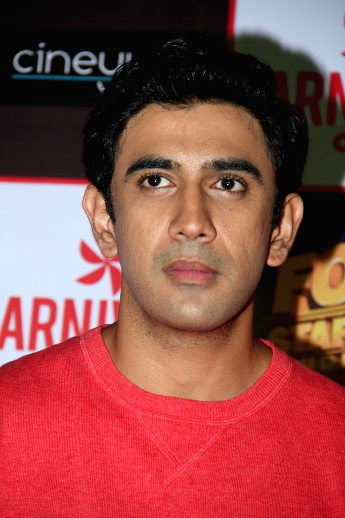 Actor Amit Sadh during the promotion of film Guddu Rangeela at the launch of Carnival Cinemas new multiplex in Mumbai on July 2, 2015. - Amit Sadh