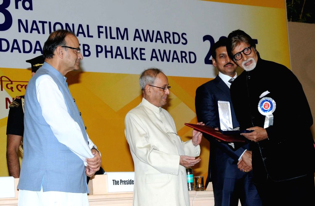 Actor Amitabh Bachchan receives the best actor award from President Pranab Mukherjee during the 63rd National Film Awards ceremony at Vigyan Bhawan  in New Delhi, on May 3, 2016. - Amitabh Bachchan and Pranab Mukherjee