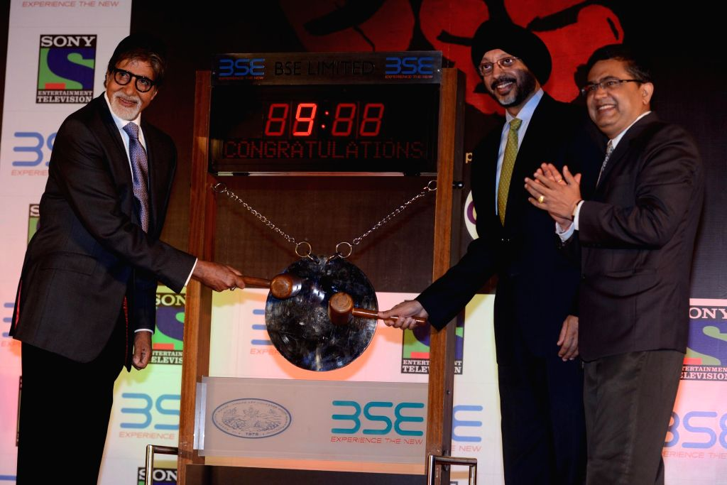 Actor Amitabh Bachchan rings the bell at Bombay Stock Exchange in Mumbai on June 17, 2014.