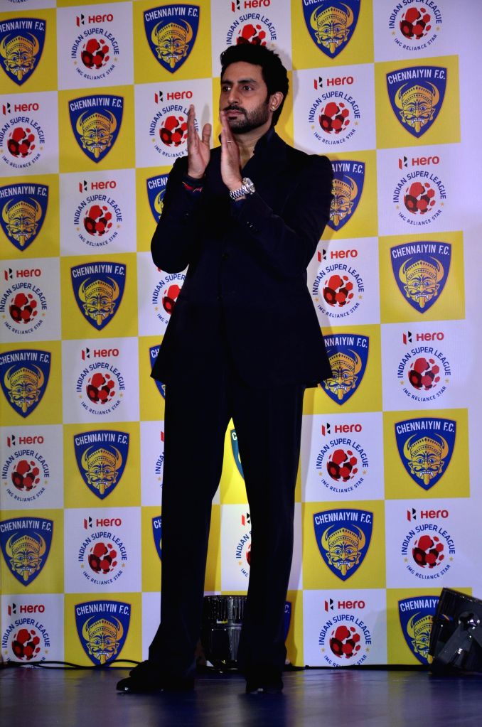 Actor and Chennaiyin FC co-owner Abhishek Bachchan and Chennaiyin FC co-owner Vita Dani along the team during a press conference in Mumbai on Oct. 9, 2014.