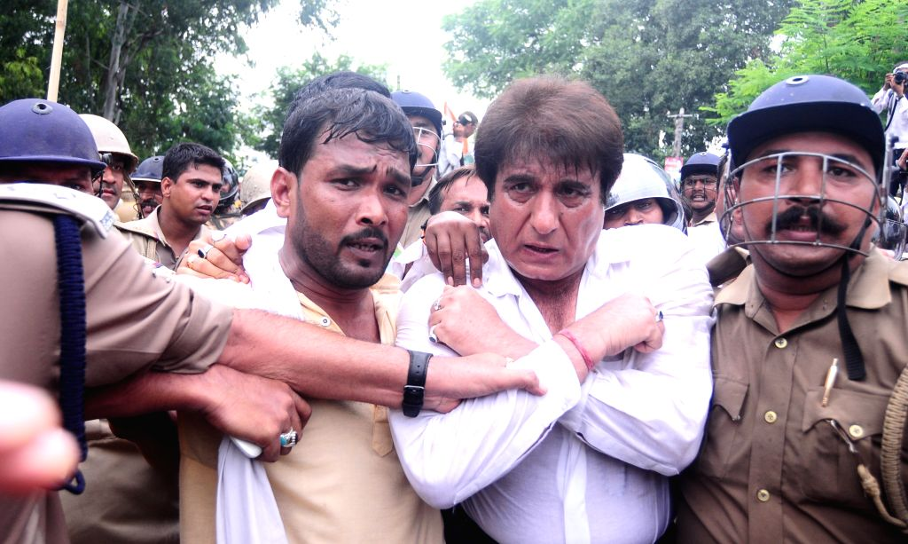 Actor and Congress leader Raj Babbar being taken away by police during a demonstration against in Lucknow, on Aug 17, 2015.