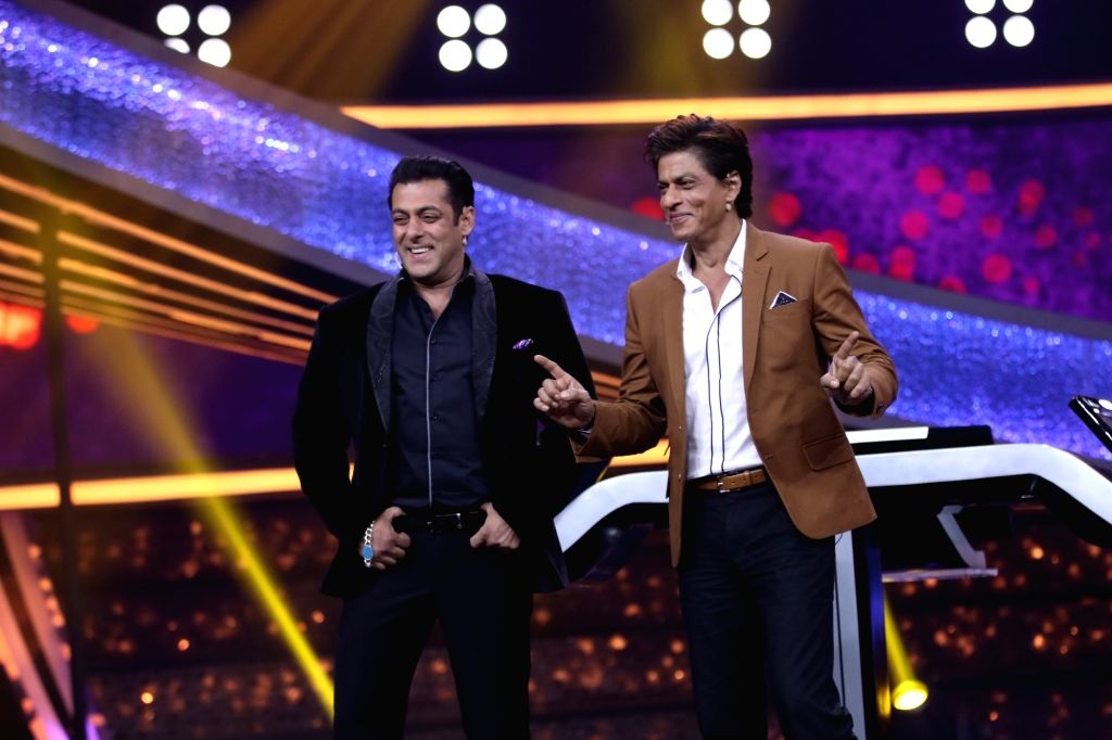Actor and host of the reality television show '10 Ka Dum', Salman Khan with actor Shah Rukh Khan on the sets of the show, in Mumbai on Sept 3, 2018. - Shah Rukh Khan and Salman Khan