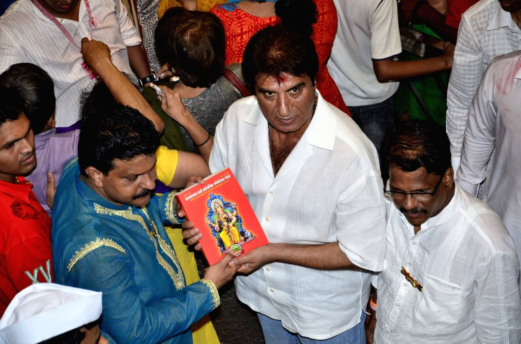 Actor and politician Raj Babbar at the Lalbaucha Raja Ganesh mandal, in Mumbai, on Sept. 6, 2014. The ten day-long Ganesh festival of the Hindu Elephant-headed god Ganesh, will end on September 8 ...