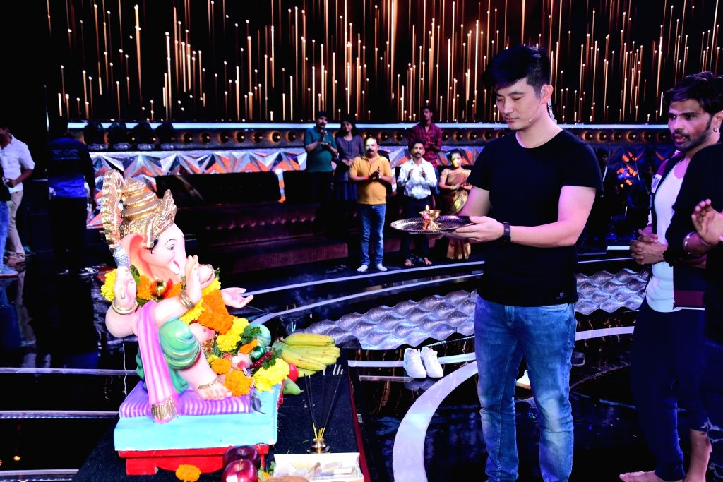"""Actor and the anchor of singing reality television show for kids """"Love Me India"""" Meiyang Chang performs Ganesh 'arti' during Ganesh Chaturthi celebrations on the sets of the show, ..."""