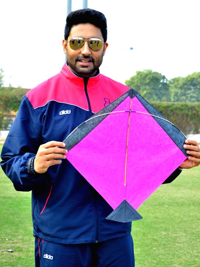 Actor and the owner of Jaipur Pink Panther - kabaddi team, Abhishek Bachchan poses with a kite during Makar Sankranti celebrations in Jaipur, on Jan 15, 2016.
