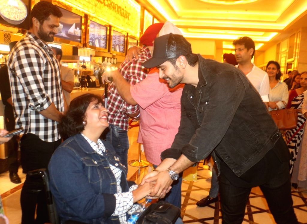 "Actor Angad Bedi and Indian para-athlete Deepa Malik at the special screening of film ""Soorma"" in New Delhi on July 19, 2018. - Angad Bedi and Malik"