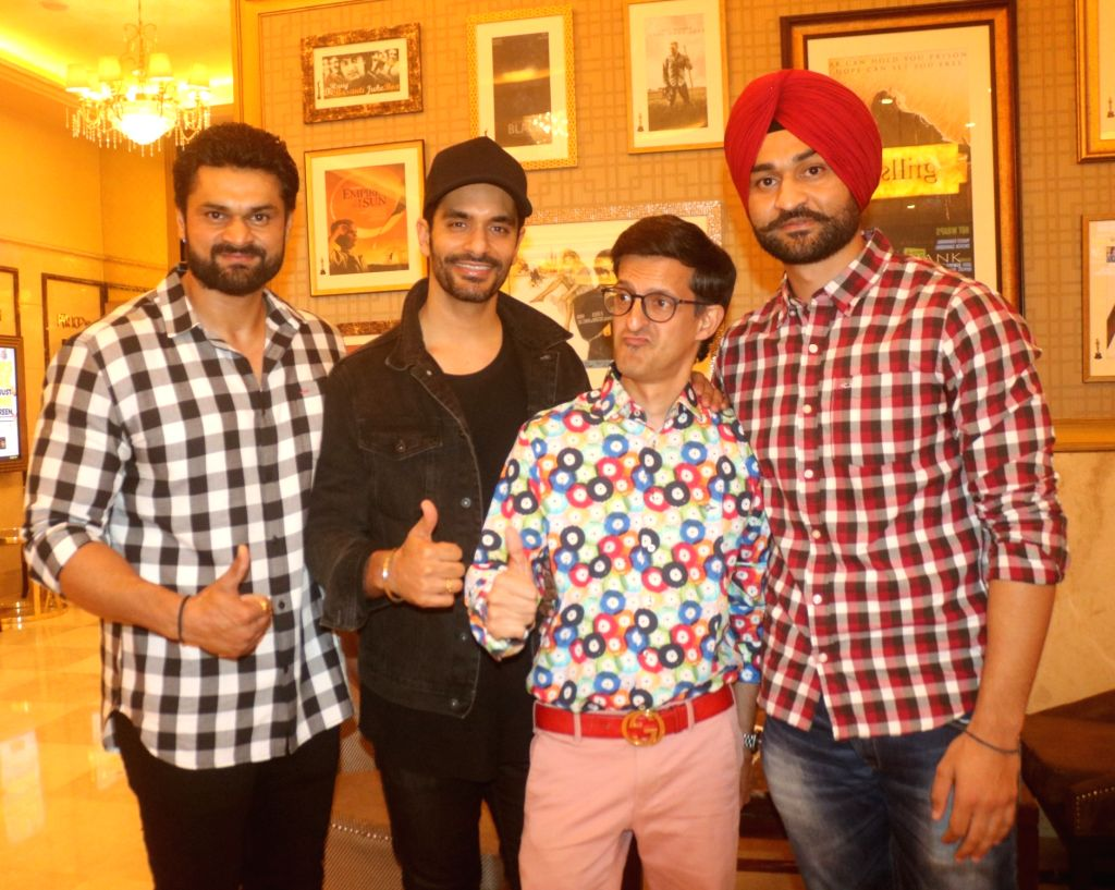 Actor Angad Bedi, cricket commentator Gautam Bhimani and former Hockey player Sandeep Singh along with his elder brother Bikramjeet Singh at the special screening of film ... - Angad Bedi, Sandeep Singh and Bikramjeet Singh