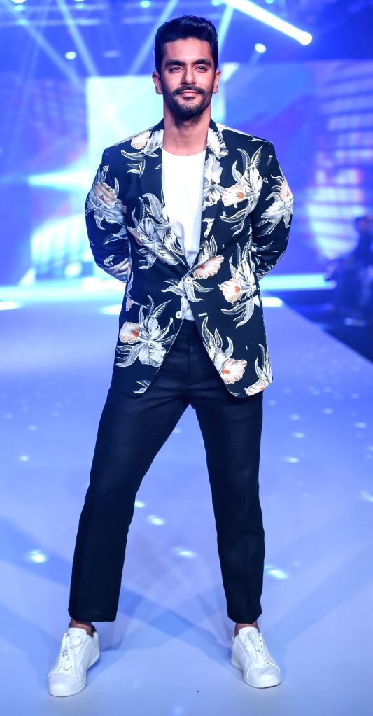 Actor Angad Bedi during fashion designer Narendra Kumar's show on the second day of Bombay Times Fashion Week 2018, in Mumbai on March 31, 2018. - Angad Bedi and Narendra Kumar