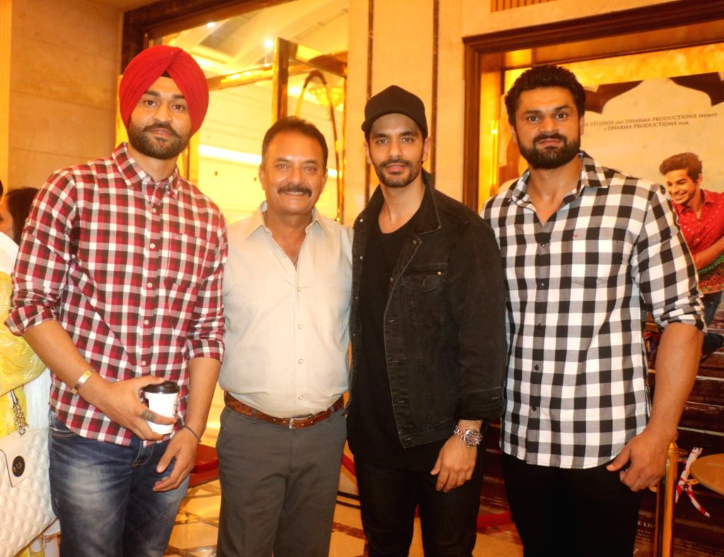 "Actor Angad Bedi, former India cricketer Madan Lal and former Hockey player Sandeep Singh along with his elder brother Bikramjeet Singh at the special screening of film ""Soorma"" ... - Angad Bedi, Sandeep Singh and Bikramjeet Singh"