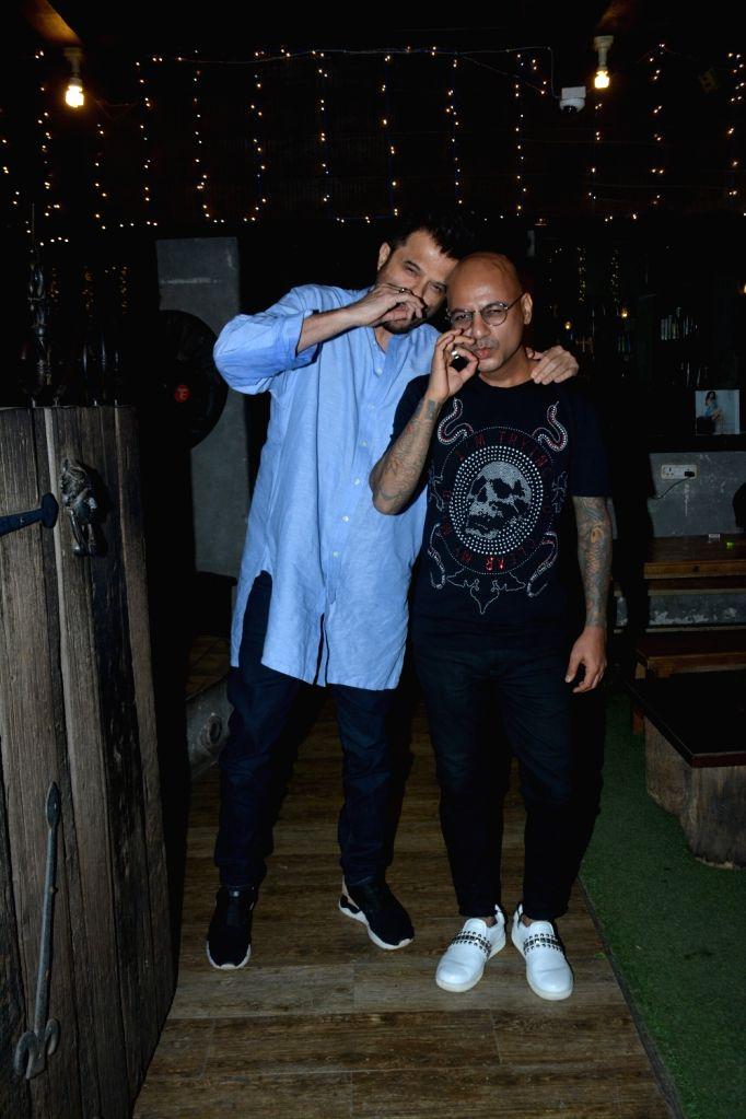 Actor Anil Kapoor and celebrity hairstylist Aalim Hakim seen at a Bandra salon, in Mumbai on Feb 20, 2019. - Anil Kapoor