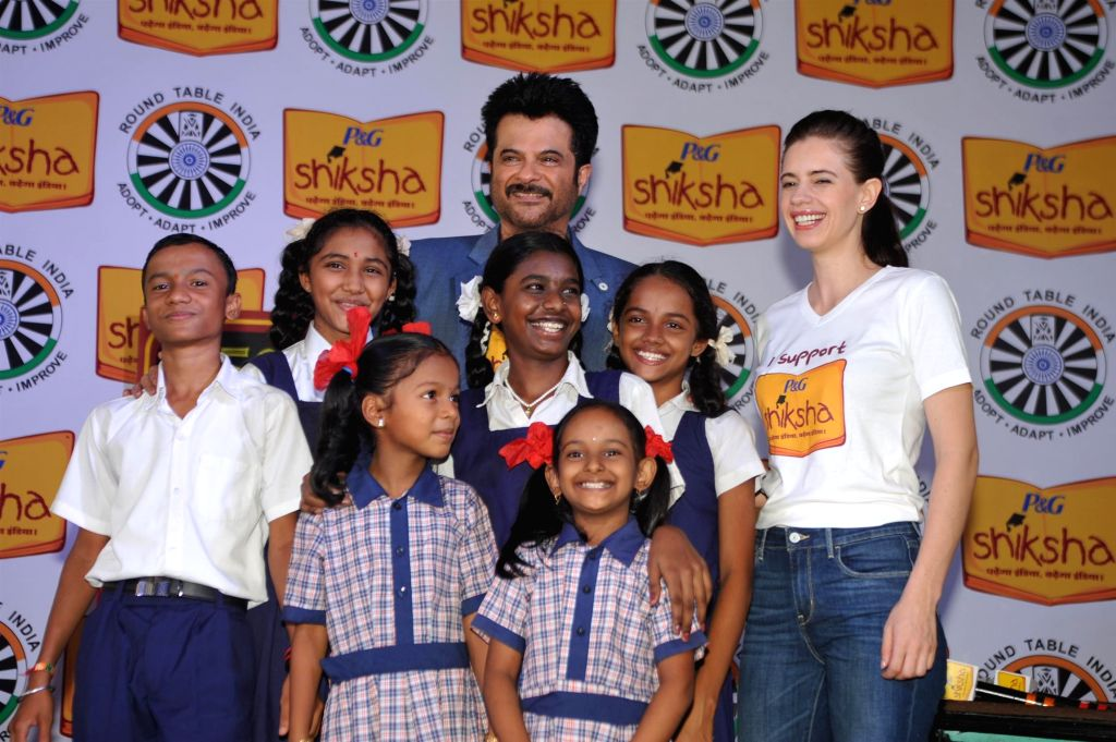 Actor Anil Kapoor and Kalki Koechlin pledge their support towards a brighter India by spreading the Joy of Shiksha amongst the lesser privileged children of India, in Mumbai on June 25, 2015.