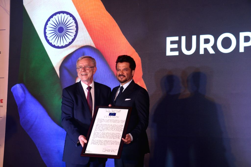 Actor Anil Kapoor being felicitated by EU Ambassador to India Tomasz Kozlowski for his support to promoting the cause of children's rights and his collaboration with the EU and Plan India in ... - Anil Kapoor
