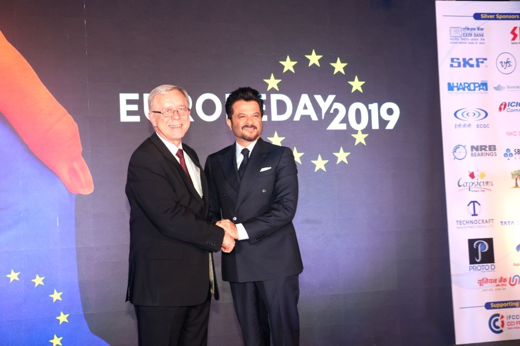 Actor Anil Kapoor with EU Ambassador to India Tomasz Kozlowski during 'Europe Day' celebrations where he was felicitated by the Council of European Chambers of Commerce (CEUCC) in India and ... - Anil Kapoor