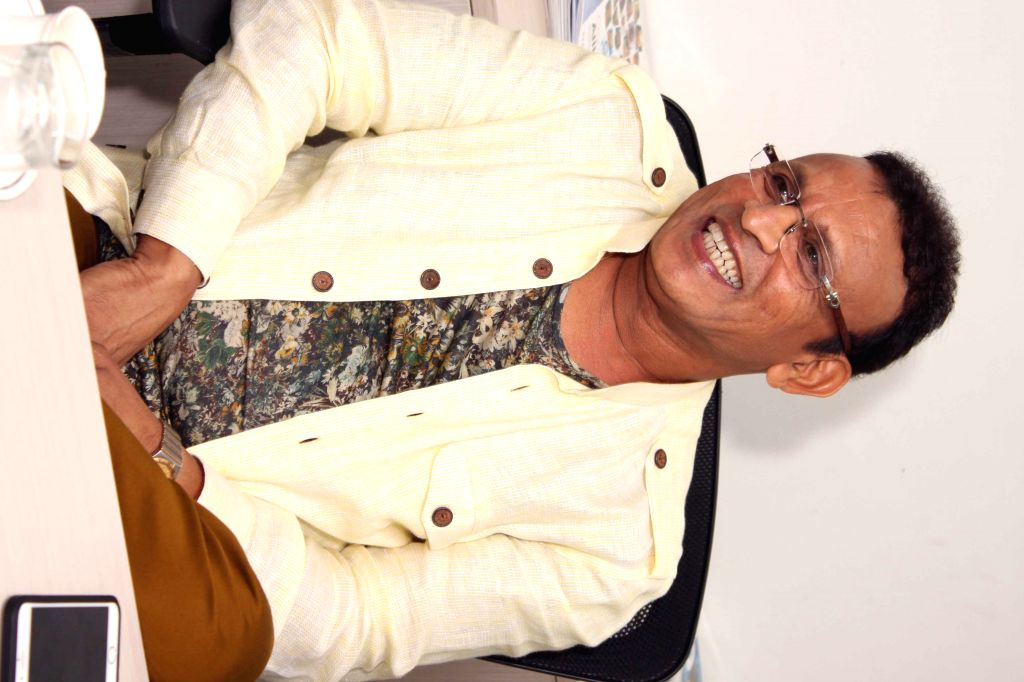 Actor Annu Kapoor during an interaction at the office of IANS, in New Delhi, on June 22, 2015. - Annu Kapoor