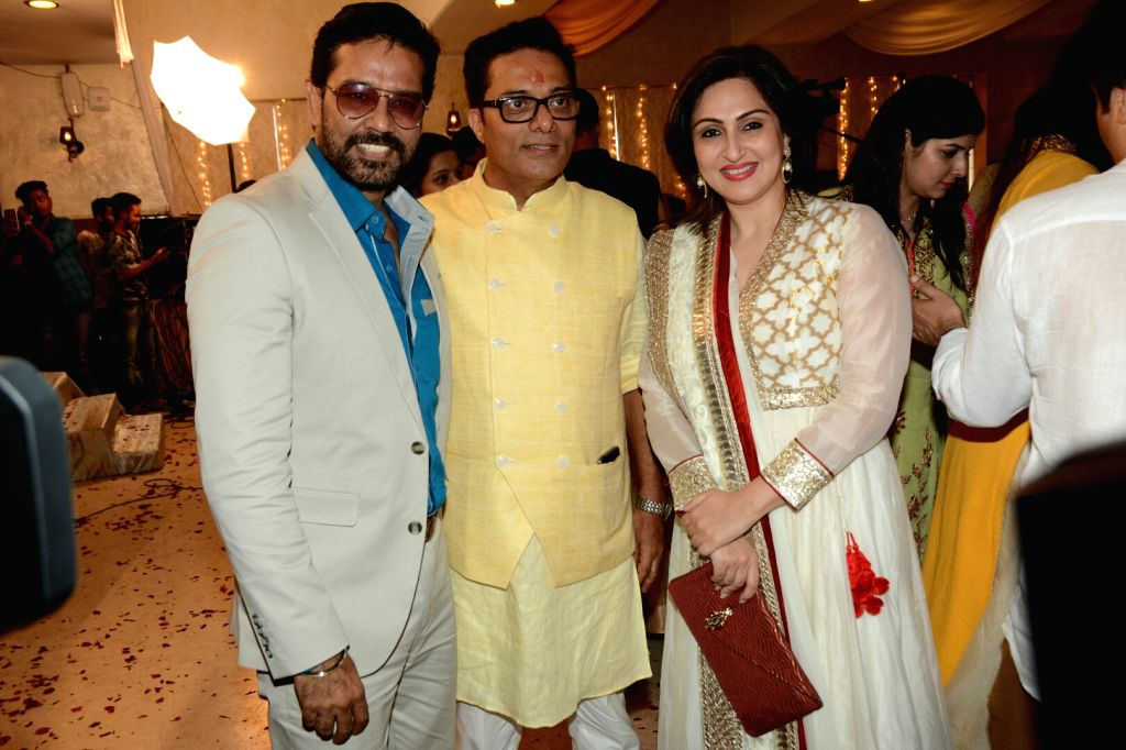 Actor Anup Soni and wife Juhi Babbar with Assistant Commissioner of Customs (Preventive Wing) Deepak Pandit at the the Haldi ceremony of his son, in Mumbai's Juhu on May 28, 2018. - Anup Soni