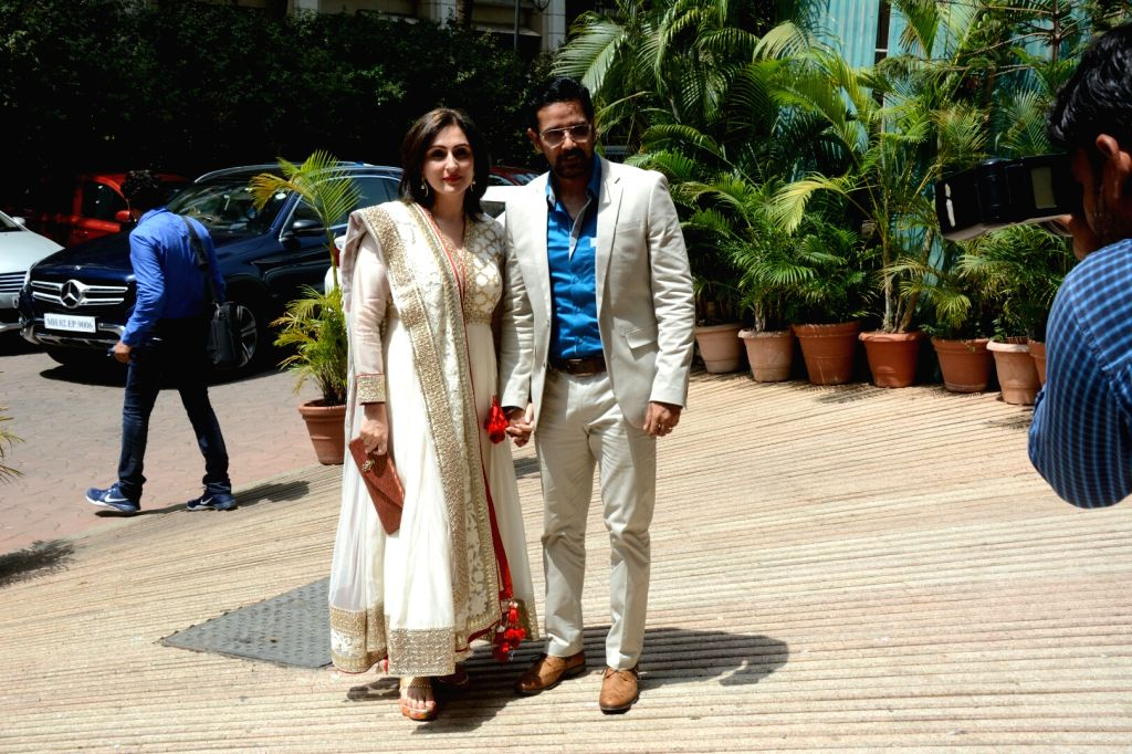 Actor Anup Soni with wife Juhi Babbar arrive at the Haldi ceremony of son of  Assistant Commissioner of Customs (Preventive Wing) Deepak Pandit, in Mumbai's Juhu on May 27, 2018. - Anup Soni