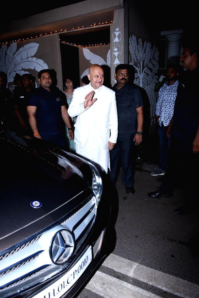Actor Anupam Kher at actor Amitabh Bachchan's Diwali party in Mumbai on Oct 27, 2019. - Anupam Kher and Amitabh Bachchan
