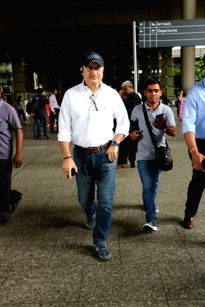 Actor Anupam Kher at Chhatrapati Shivaji Maharaj International Airport in Mumbai on July 5, 2017. - Anupam Kher