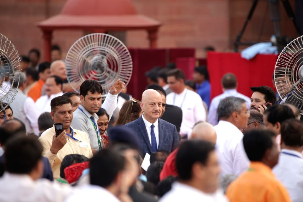 Actor Anupam Kher at Prime Minister Narendra Modi and his new cabinet's oath-taking ceremony at the Rashtrapati Bhavan in New Delhi on May 30, 2019. - Anupam Kher and Narendra Modi