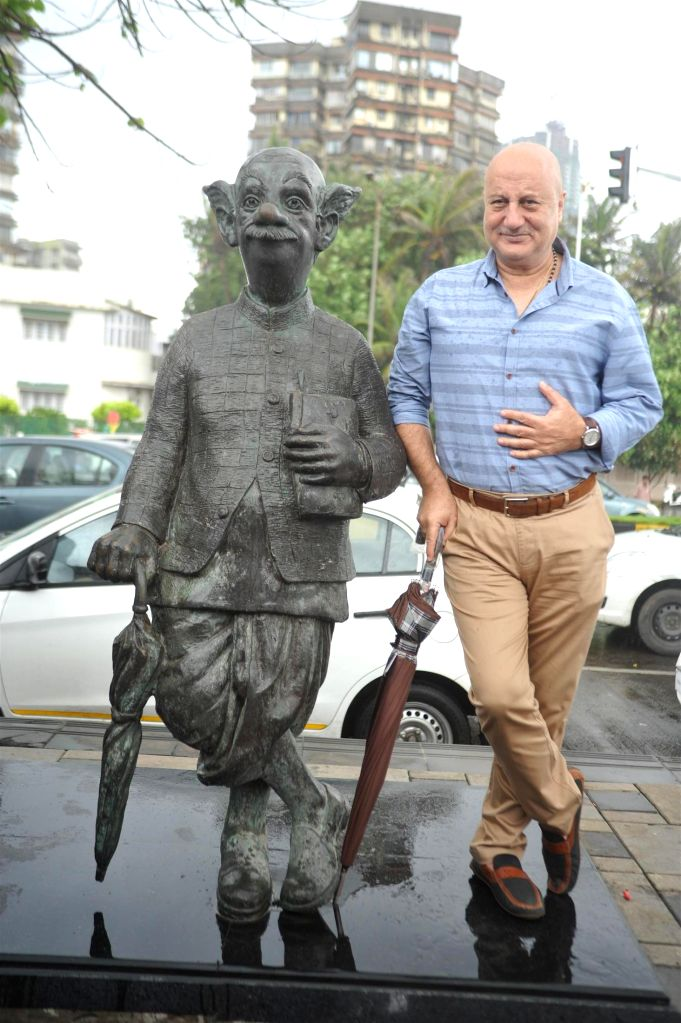 Actor Anupam Kher during the promotion of film Ekkees Toppon Ki Salaami in Mumbai on Sept 9, 2014. The Team of Ekkees Toppon Ki Salaami paid a tribute to R. K. Laxman's Common Man Statue which has ... - Anupam Kher