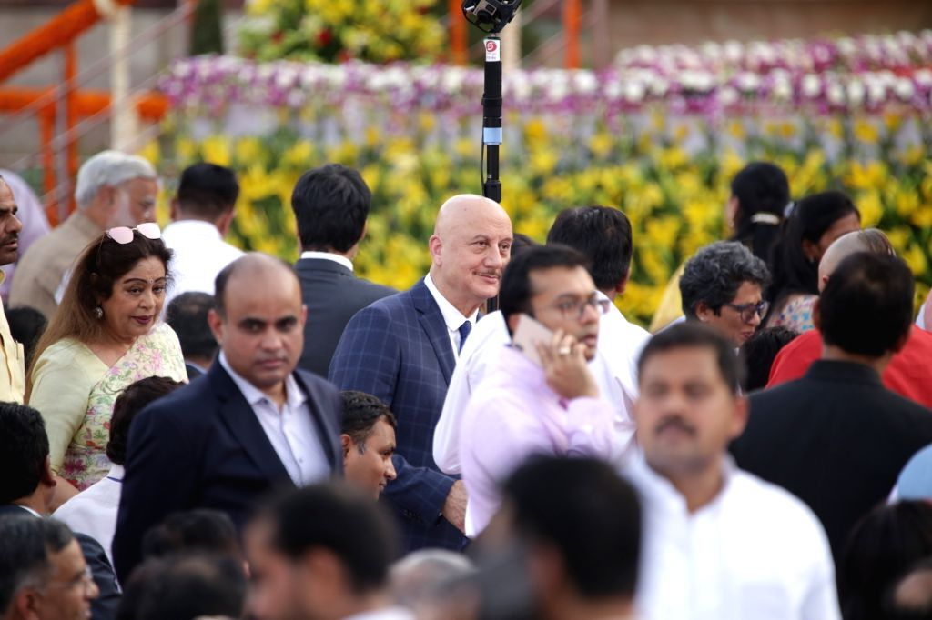Actor Anupam Kher with his wife and Chandigarh BJP MP Kirron Kher at Prime Minister Narendra Modi and his new cabinet's oath-taking ceremony at the Rashtrapati Bhavan in New Delhi on May ... - Anupam Kher, Narendra Modi and Kirron Kher