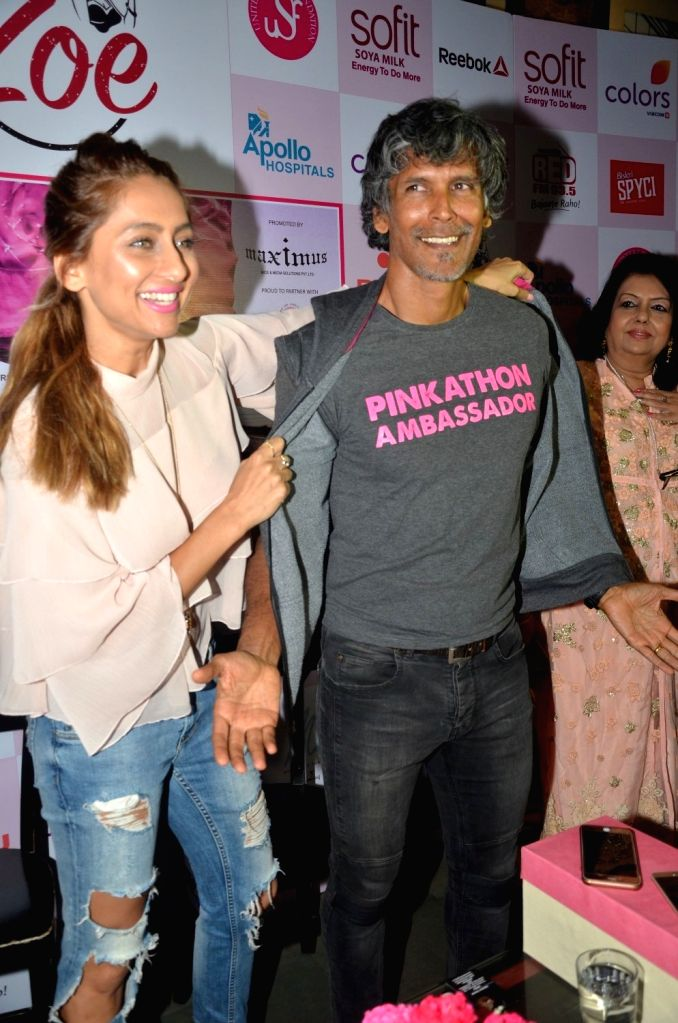 Actor Anusha Dandekar and model Milind Soman during the announcement of Fifth Edition of Pinkathon, India`s biggest women`s run in Mumbai on Nov 22, 2016. - Anusha Dandekar