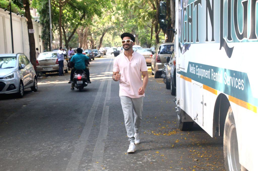 Actor Aparshakti Khurana seen during a shoot in Mumbai's Juhu, on April 24, 2019. - Aparshakti Khurana
