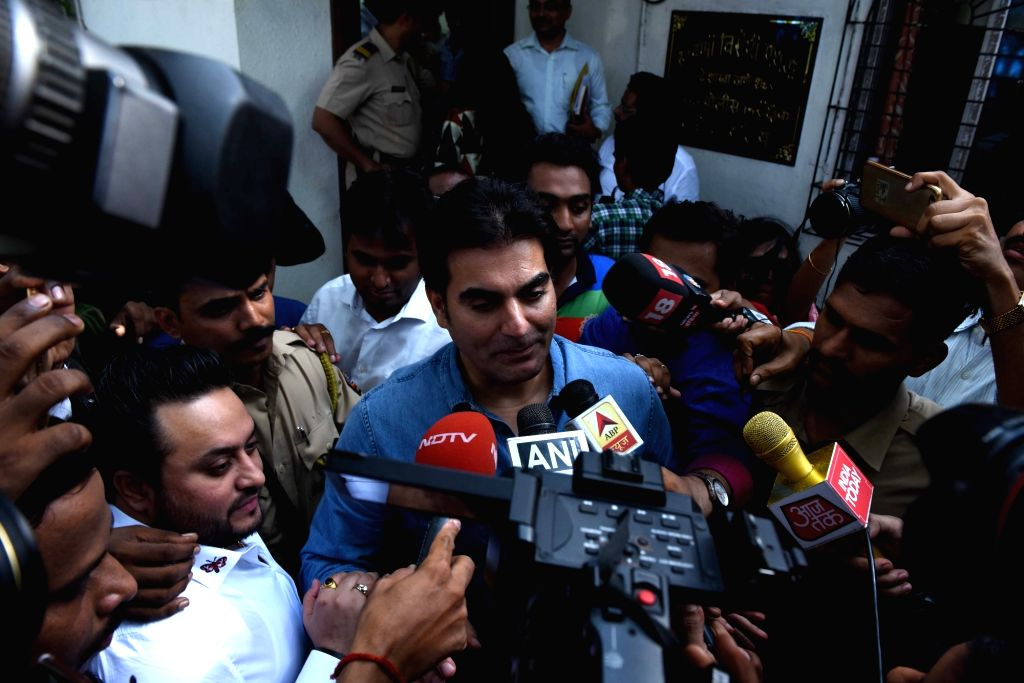 Actor Arbaaz Khan talks to press outside Thane Anti Extortion Cell in Thane on June 2, 2018. Khan was summoned before the AEC regarding IPL betting scam since the past five-six years involving ... - Arbaaz Khan