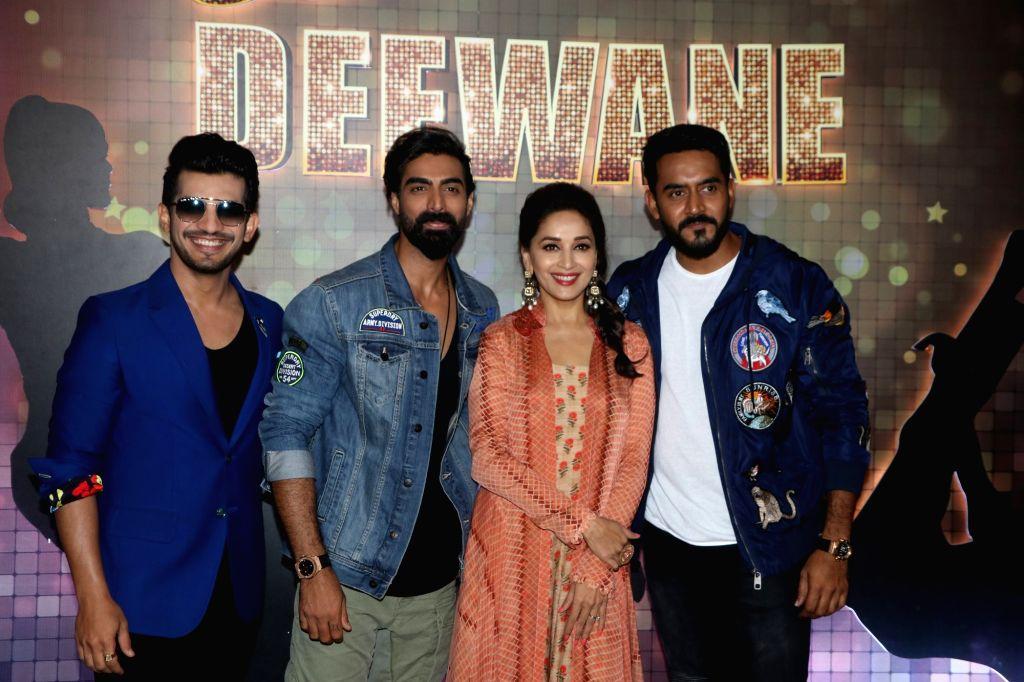 "Actor Arjun Bijlani, Madhuri Dixit Nene and director Shashank Khaitan during a interview regarding their dance reality show ""Dance Deewane"" in Mumbai on May 24, 2018. - Arjun Bijlani and Madhuri Dixit Nene"