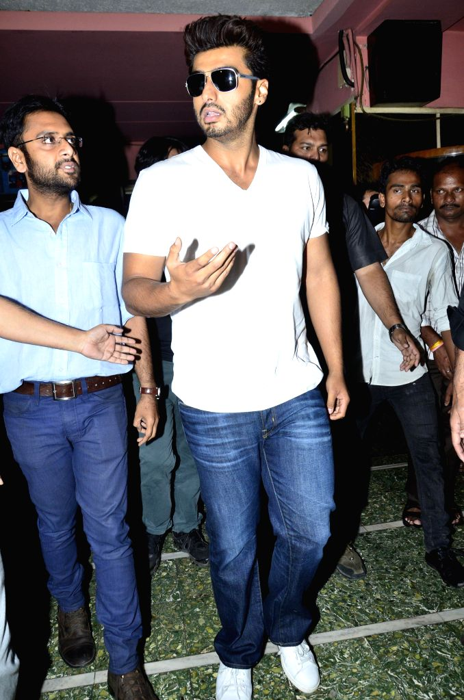 Actor Arjun Kapoor catches audience reaction of `2 States` at Gaiety Cinemas in Mumbai, on April 18, 2014.