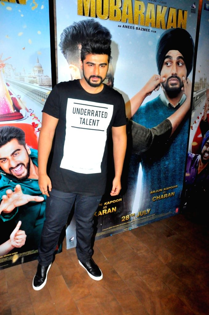 Actor Arjun Kapoor celebrates his birthday during the promotion of film Mubarakan in Mumbai on June 25, 2017. - Arjun Kapoor