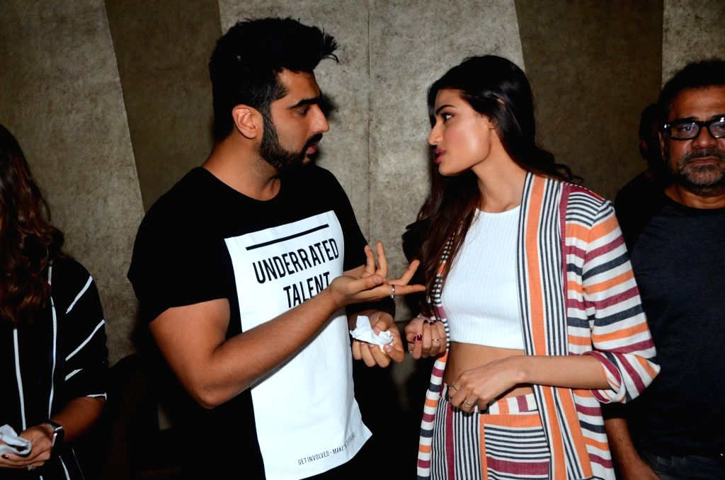 Actor Arjun Kapoor celebrates his birthday with his costar during the promotion of film Mubarakan in Mumbai on June 25, 2017. - Arjun Kapoor