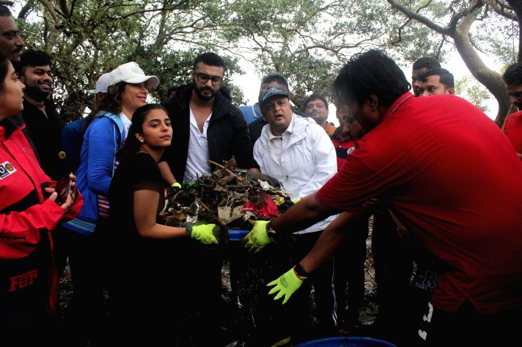 Actor Arjun Kapoor flags off beach clean-up drive at Carter Road in Mumbai on Aug 4, 2019. - Arjun Kapoor