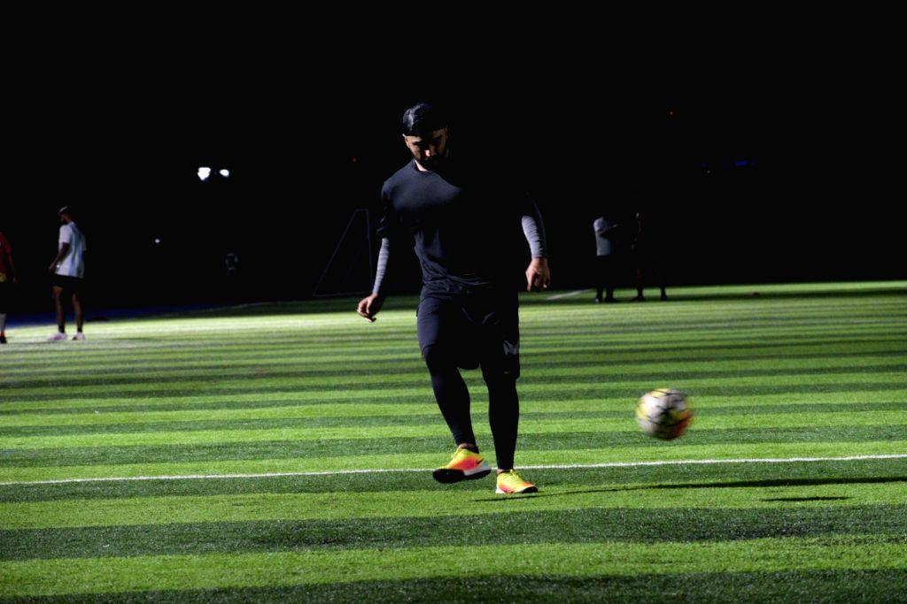 Actor Arjun Kapoor plays football at Juhu in Mumbai, on July 25, 2019. - Arjun Kapoor