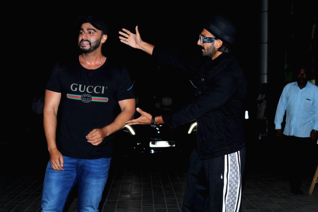 "Actor Arjun Kapoor with actor Ranveer Singh seen at the screening of his upcoming film ""India's Most Wanted"", in Mumbai, on May 23, 2019. - Arjun Kapoor and Ranveer Singh"