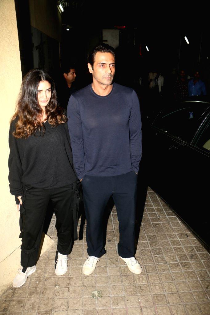 """Actor Arjun Rampal and Gabriella Demetriades at the screening of upcoming film """"Kedarnath"""" in Mumbai on Dec 5, 2018. - Arjun Rampal"""