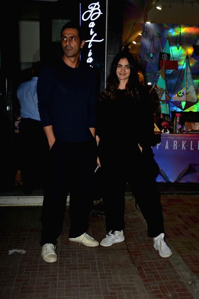 Actor Arjun Rampal and Gabriella Demetriades seen at Mumbai's Bandra on Dec 5, 2018. - Arjun Rampal