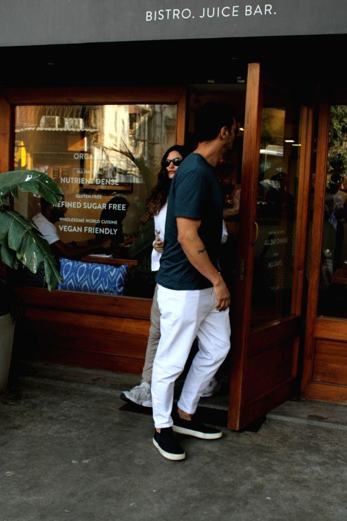 Actor Arjun Rampal with his girlfriend Gabriella Demetriades seen in Mumbai's Bandra, on March 14, 2019. - Arjun Rampal