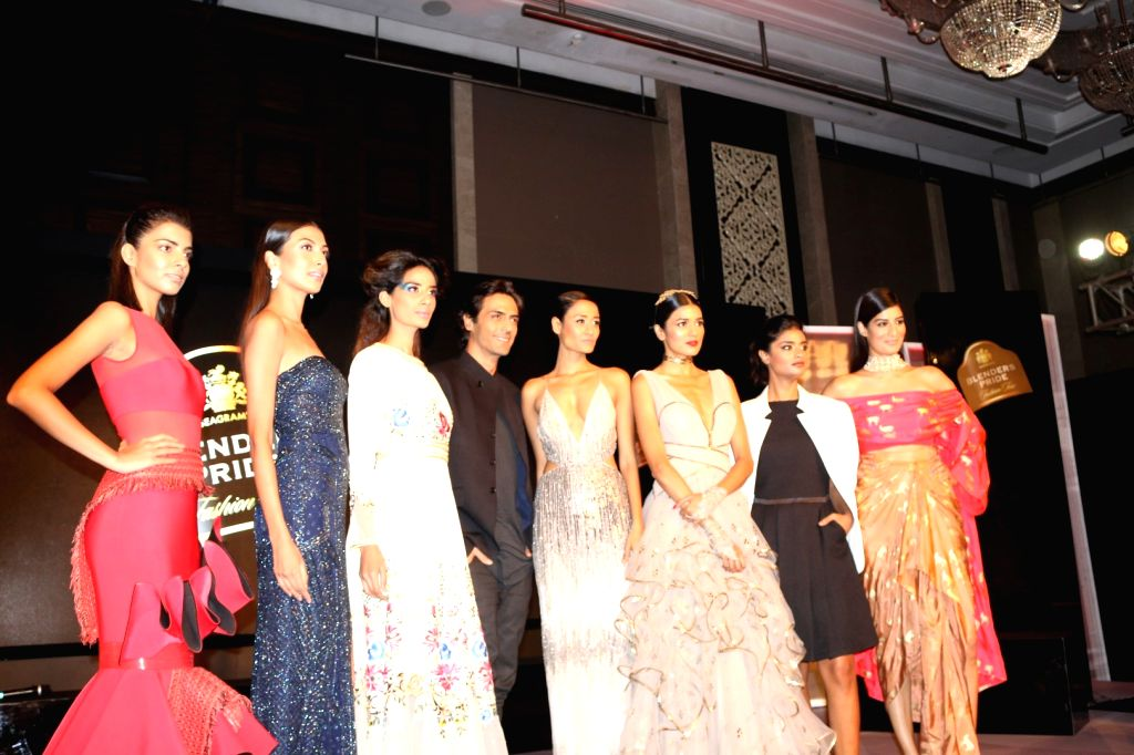 Actor Arjun Rampal with models during the unveiling of Reflections of Style at the preview of Blenders Pride Fashion Tour in Mumbai, on Oct 3, 2016. - Arjun Rampal